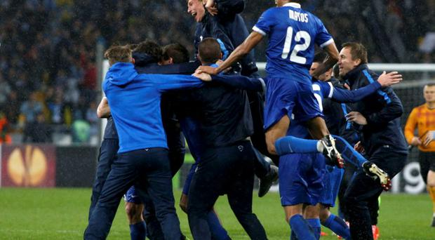 Dnipro Dnipropetrovsk's players, coaches and staff celebrate their victory over Napoli in the Europa League semi-final second leg soccer match at the Olympic stadium in Kiev