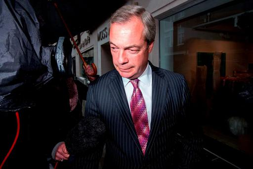 UKIP leader Nigel Farage leaves the party's head offices in central London. Photo: Getty Images