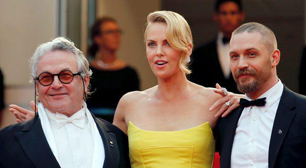 (L-R) Director George Miller, cast members Charlize Theron and Tom Hardy pose on the red carpet as they arrive for the screening of the film