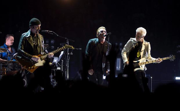 The band U2 performs in their first concert of their new world tour in Vancouver, Thursday, May, 14, 2015. The concert opens a 19-city tour, playing indoor arenas after a decade of larger outdoor shows. (Jonathan Hayward/The Canadian Press via AP) MANDATORY