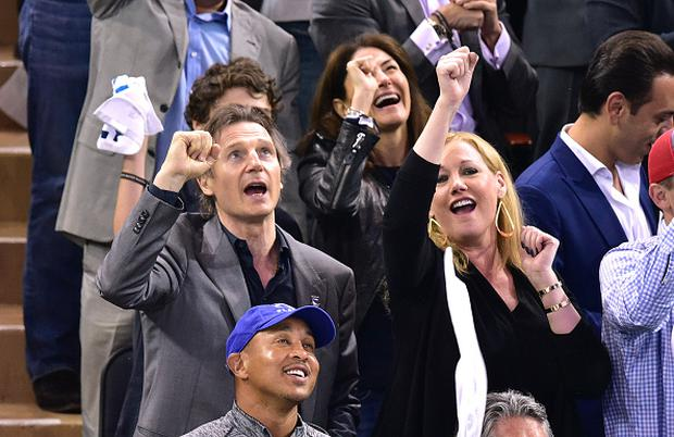 Liam Neeson and his guest at Madison Square Gardens, New York City.