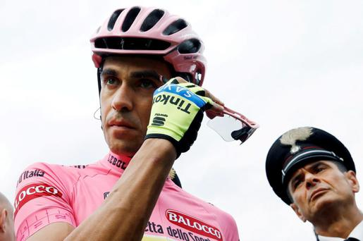 Overall leader, pink jersey Spanish rider Alberto Contador (Tinkoff Saxo) gestures before the start of the 7th stage of the Giro d'Italia today