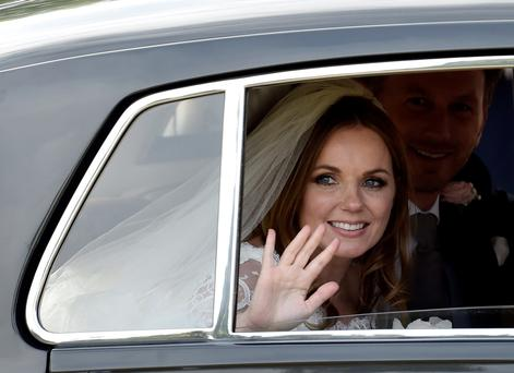 British singer and former member of the band Spice Girls, Geri Halliwell, leaves with her husband, Christian Horner, Red Bull Formula One team principal, following their wedding at St. Mary's Church at Woburn in southern England. REUTERS/Toby Melville