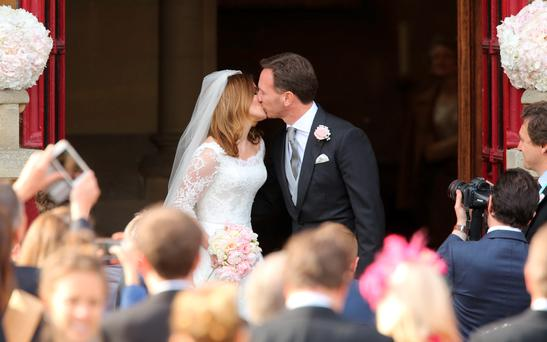 Spice Girl Geri Halliwell and her new husband Formula 1 boss Christian Horner after their wedding at St Mary's Church in Woburn, Bedfordshire. Photo: Chris Radburn/PA Wire