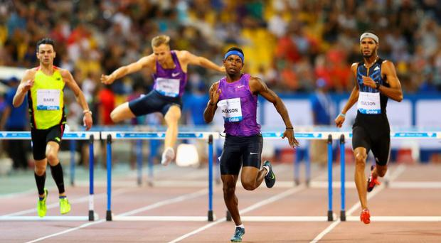 Bershawn Jackson of the United States (2R) races to the line ahead of Thomas Barr of Ireland (L), Rasmus Magi of Estonia (2L) and Javier Coulson of Puerto Rico (R) during the Doha IAAF Diamond League 2015 meeting at the Qatar Sports Club in Doha, Qatar. (Photo by Francois Nel/Getty Images)