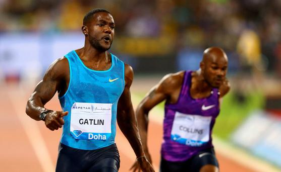 Justin Gatlin of the United States crosses the line to win the Men's 100m with Kim Collins of St Kitts and Nevis (R) finishing fourth during the Doha IAAF Diamond League 2015 meeting at the Qatar Sports Club in Doha, Qatar. (Photo by Francois Nel/Getty Images)