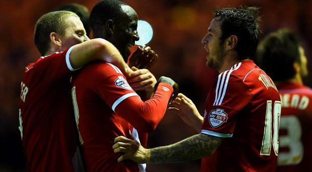 Albert Adomah of Middlesbrough (C) celebrates with Grant Leadbitter (L) and Lee Tomlin (R) as he scores their third goal during the Sky Bet Championship Playoff semi final second leg match between Middlesbrough and Brentford at the Riverside Stadium