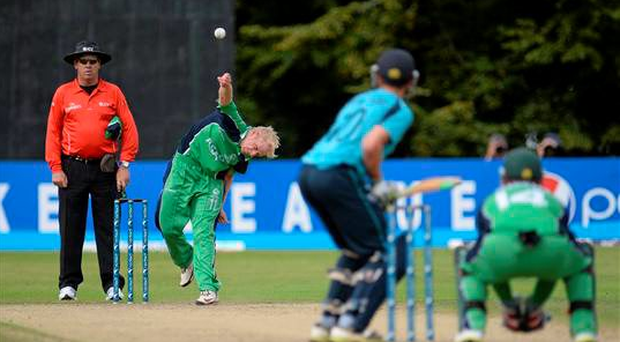 Eddie Richardson, Ireland, bowls to Richard Berrington, Scotland. World Cricket League, Ireland v Scotland, Northern Cricket Union, Stormont, Belfast, Co. Antrim in 2013 (Oliver McVeigh / SPORTSFILE)