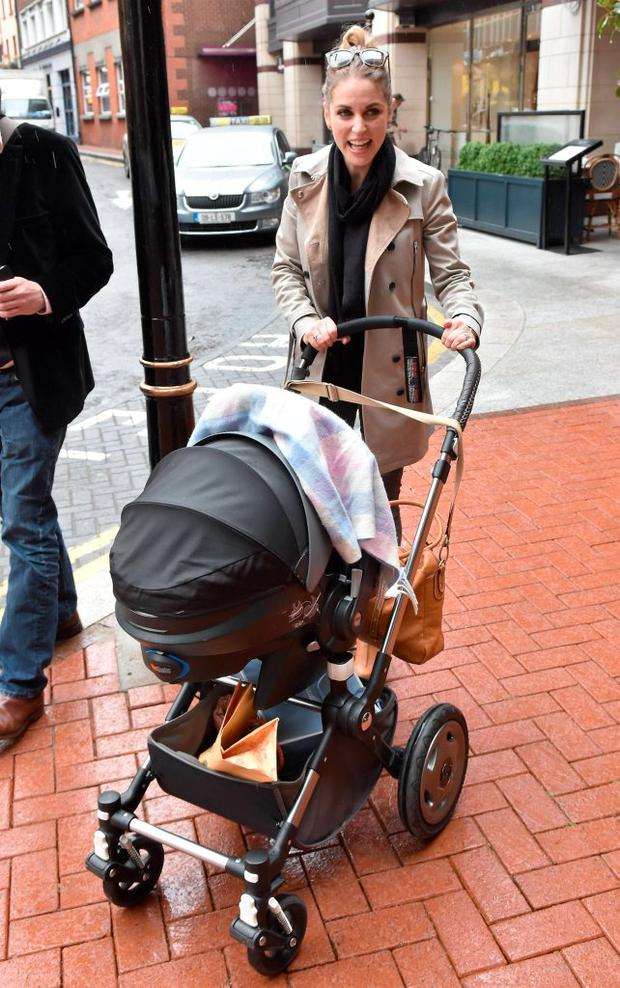 Amy Huberman spotted outside Balfes Cafe at the Westbury Hotel showing off her new baby boy Billy to friends and fellow actor Liam Cunningham, Dublin