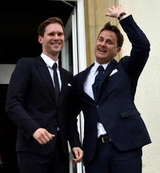 Prime Minister Xavier Bettel waves during this wedding in Luxembourg Credit: john Thys (AFP)