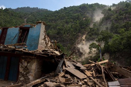 A collapsed house during a landslide after Tuesday's earthquake at Singati Village in Nepal Credit: Athit Perawongmetha