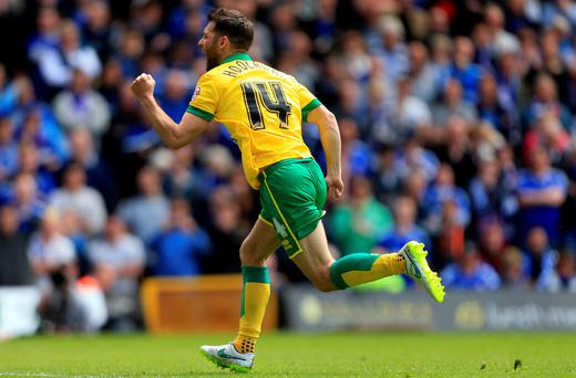WesHoolahan celebrates scoring the opening goal against Ipswich Town at Carrow Road