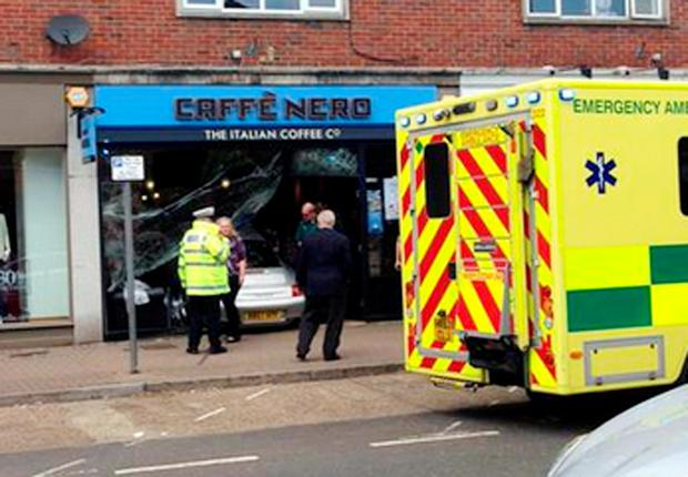 The scene of an accident at the Caffe Nero in Gerrards Cross, Buckinghamshire, this afternoon, after a Porsche crashed into the front of the building. The driver was treated for minor injuries. Photo: Jenny Hodge/PA Wire