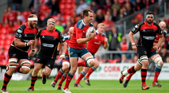Andrew Smith, Munster through the Newport Gwent Dragons defence on his way to scoring his side's first try.