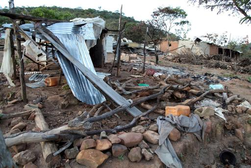 Destroyed huts in the remote Mount Sumi region in Angola following a police raid that may have resulted in over a 1000 deaths Credit: Herculano Coroado