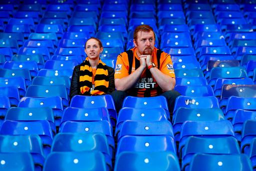Hull supporters show their dejections after the defeat to Tottenham Hotspur