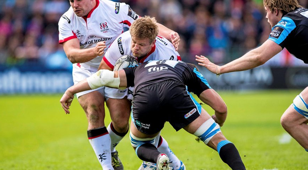Chris Henry is tackled by Adam Ashe of the Glasgow Warriors.