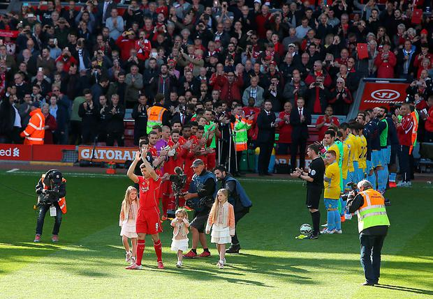 Liverpool's Steven Gerrard applauds the Anfield crowd as he is greeted by a guard of honour before the Barclays Premier League match at Anfield,
