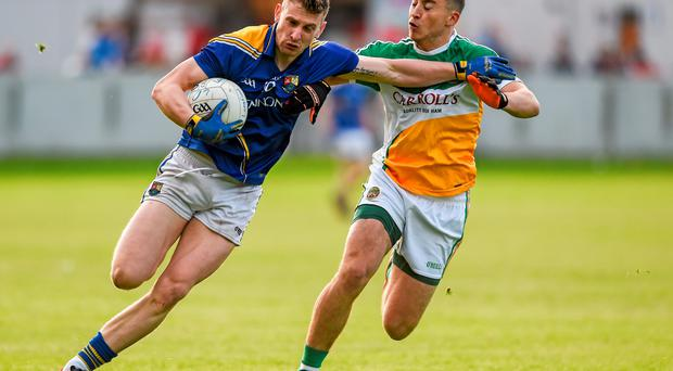 Ronan McEntire, Longford, in action against Joseph O'Connor, Offaly.Photo: Ray McManus / SPORTSFILE