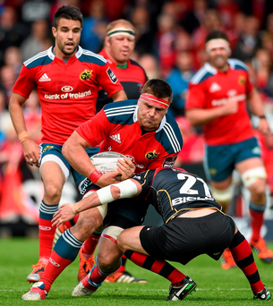 Munster's CJ Stander is tackled by Dragons' Richie Rees