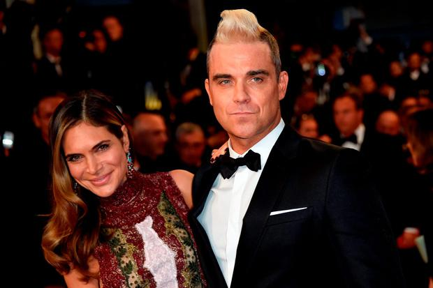 British singer Robbie Williams (R) and his wife Ayda Field pose as they arrive for the screening of the film