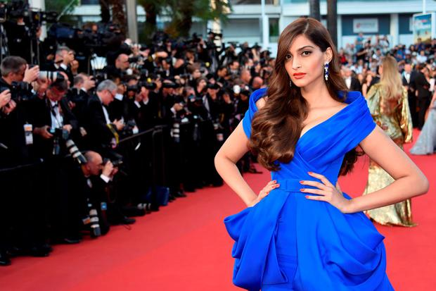 Indian actress Sonam Kapoor poses as she arrives for the screening of the film