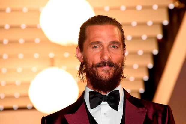 US actor Matthew McConaughey smiles before leaving the Festival palace after the screening of the film