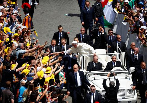 Pope Francis greets the faithful as he leaves at the end of the ceremony for the canonisation of four nuns at Saint Peter's square in the Vatican City REUTERS/Tony Gentile