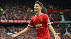 Ander Herrera celebrates scoring against Arsenal at Old Trafford