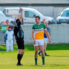 Offaly's Niall Smith is shown a Black Card by referee Padraig O'Sullivan during the firast half. Leinster GAA Football Senior Championship, Round 1, Offaly v Longford (Ray McManus / SPORTSFILE)