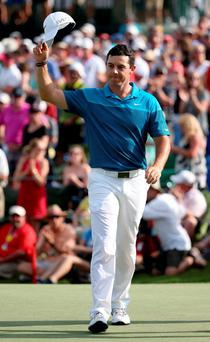 Rory McIlroy reacts after putting in to win on the 18th hole during the final round at the Wells Fargo Championship at Quail Hollow Club on May 17, 2015 in Charlotte, North Carolina. (Photo by Streeter Lecka/Getty Images)