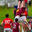 Westmeath duo Kieran Martin, left, and Ray Connelan contest possession with Louth's Ruairi Moore RAMSEY CARDY/SPORTSFILE