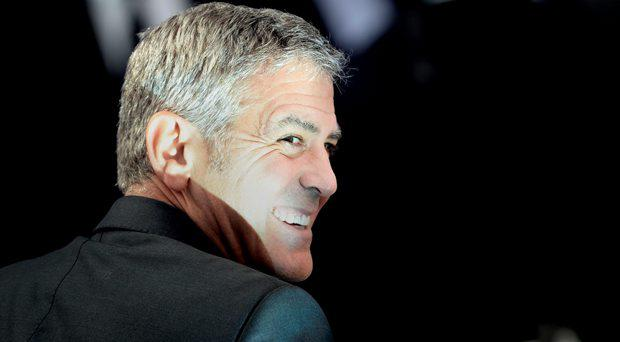 George Clooney arrives for the premiere of Tomorrowland: