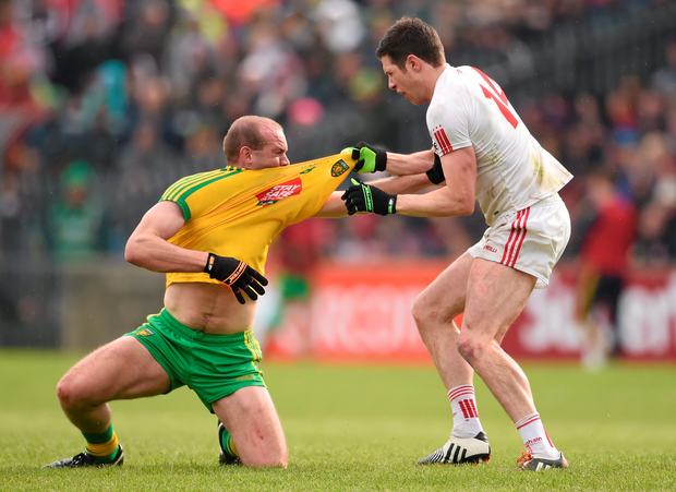 17 May 2015; Neil Gallagher, Donegal, and Sean Cavanagh, Tyrone, tussle off the ball. Ulster GAA Football Senior Championship, Preliminary Round, Donegal v Tyrone. MacCumhaill Park, Ballybofey, Co. Donegal. Picture credit: Stephen McCarthy / SPORTSFILE