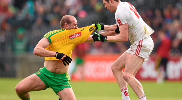 Neil Gallagher of Donegal, and Tyrone's Sean Cavanagh, tussle off the ball. Both players were sent off by referee Joe McQuillan in an ill-tempered affair at Ballybofey