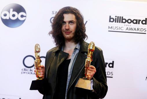 Musician Hozier poses backstage with his awards for Top Rock Artist and Top Rock Song for