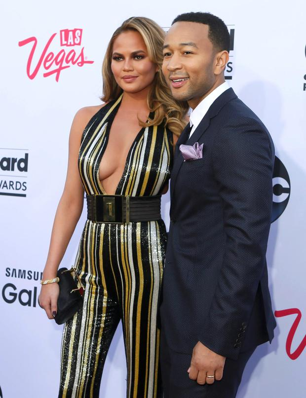 Model Chrissy Teigen and her singer husband John Legend arrive at the 2015 Billboard Music Awards in Las Vegas, Nevada May 17, 2015. REUTERS/L.E. Baskow
