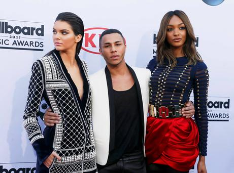 Model Kendall Jenner (L), designer Olivier Rousteing and model Jourdan Dunn arrive at the 2015 Billboard Music Awards in Las Vegas, Nevada May 17, 2015. REUTERS/L.E. Baskow