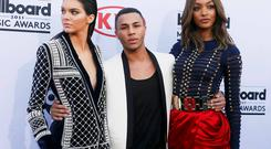 8b380f13 Model Kendall Jenner (L), designer Olivier Rousteing and model Jourdan Dunn  arrive at