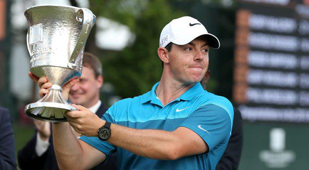 Rory McIlroy holds up the championship trophy during the final round at Quail Hollow Club. Rory McIllroy becomes the first two time winner of the Wells Fargo Championship