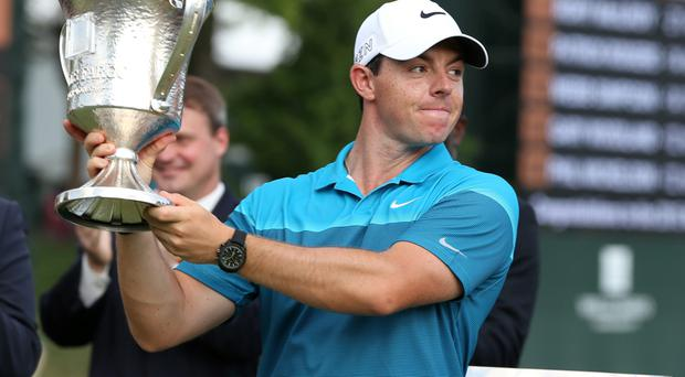 Rory McIlroy holds up the championship trophy during the final round at Quail Hollow Club.