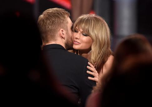 Taylor Swift, right, hugs Calvin Harris after winning the award for top billboard 200 album for 1989 at the Billboard Music Awards at the MGM Grand Garden Arena on Sunday, May 17, 2015, in Las Vegas. (Photo by Chris Pizzello/Invision/AP)