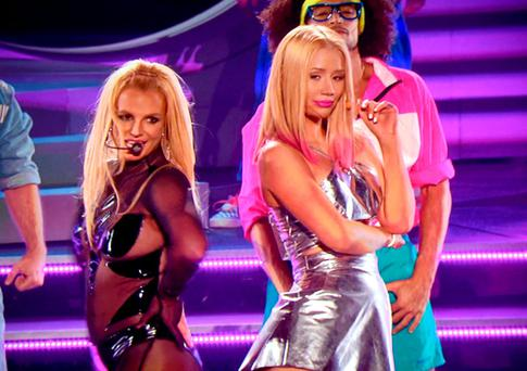 LAS VEGAS, NV - MAY 17: Recording artists Britney Spears (L) and Iggy Azalea perform via video during the 2015 Billboard Music Awards at MGM Grand Garden Arena on May 17, 2015 in Las Vegas, Nevada. (Photo by Kevin Mazur/BMA2015/WireImage)