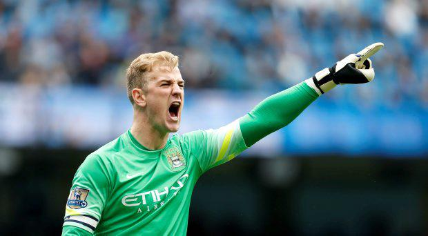 Manchester City goalkeeper Joe Hart shouts and gestures during the Barclays Premier League match at the Etihad Stadium, Manchester