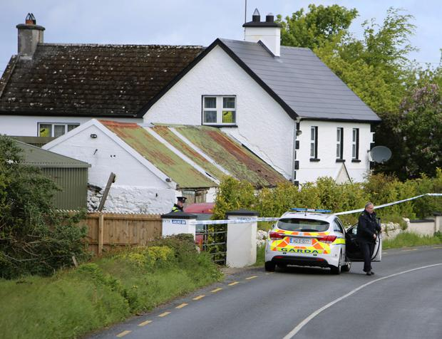 The scene near Askeaton on the Rathkeale road where the bodies of a man and woman were located at 3.00am on Monday morning. Photograph Liam Burke/Press 22