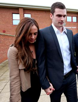 England footballer Adam Johnson and his partner Stacey Flounders leave Peterlee Magistrates' Court in County Durham where he faced three offences of sexual activity with a girl under 16 and one of grooming