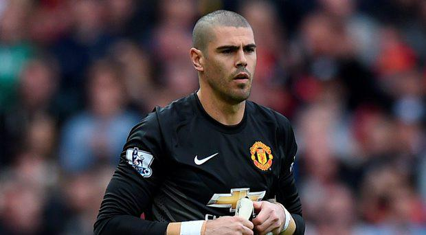 Manchester United's Spanish goalkeeper Victor Valdes walks onto the pitch after a substitution during the English Premier League football match between Manchester United and Arsenal at Old Trafford in Manchester, northwest England, on May 17, 2015.