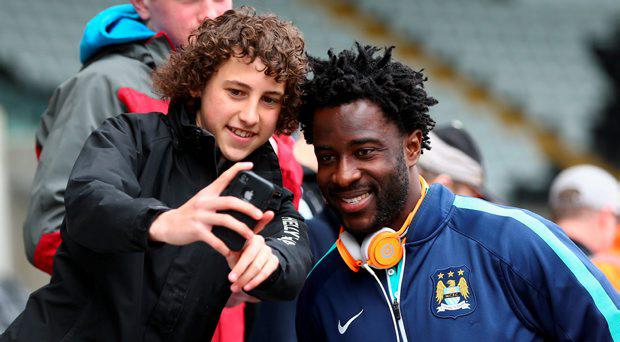 Wilfried Bony of Manchester City poses for a photograph as he arrives at the stadium during the Barclays Premier League match between Swansea City and Manchester City at Liberty Stadium on May 17, 2015 in Swansea, Wales. (Photo by Michael Steele/Getty Images)