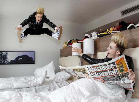 Jedward(john and Edward Grimes) having a bit of fun in their Hotel Room in Dusseldorf at the Eurovision Song Contest..KOBPIX ....NO FEE PIX