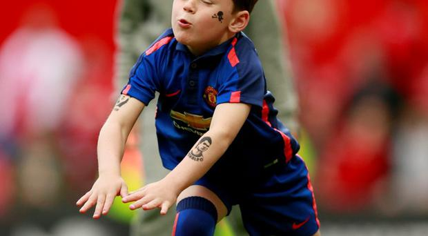 Son of Manchester United's Wayne Rooney, Kai, during a lap of honour after the 1-1 draw against Arsenal at Old Trafford.